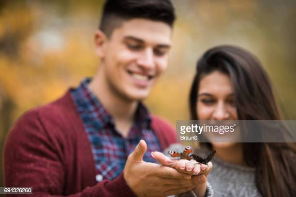 butterflies in hands of happy couple. - releasing stock photos and pictures