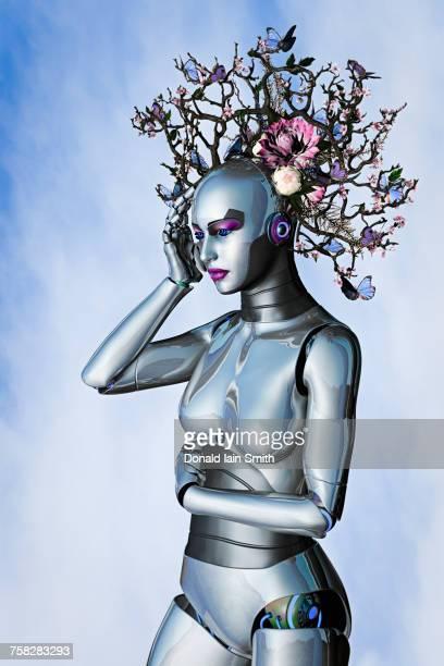 Butterflies on branch headdress of woman robot
