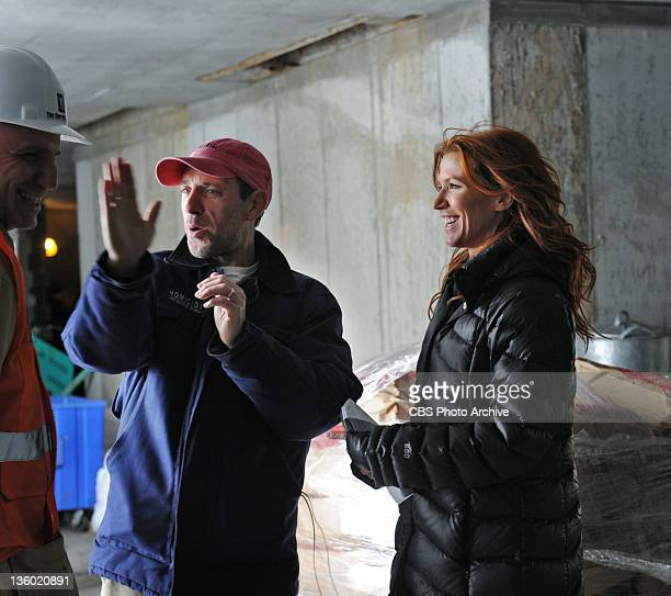 Butterfly Effect Poppy Montgomery discusses a scene with director Jace Alexander on the set of UNFORGETTABLE Tuesday Jan 3 on the CBS Television...