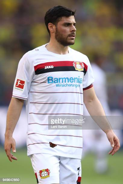 A butterfly is seen on the shirt of Kevin Volland of Bayer Leverkusen during the Bundesliga match between Borussia Dortmund and Bayer 04 Leverkusen...