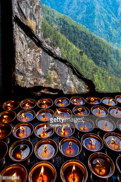 butterlamp at tiger nest trail, bhutan - paro district stock pictures, royalty-free photos & images