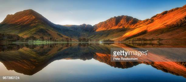 buttermere reflections - cumbria stock photos and pictures