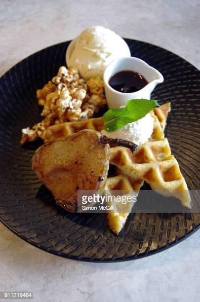 Buttermilk waffle, honey baked pear, vanilla gelato, caramel popcorn and maple syrup