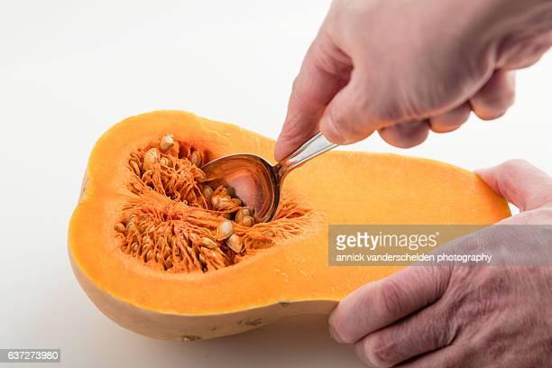 Butternut pumpkin. Removing the seeds.