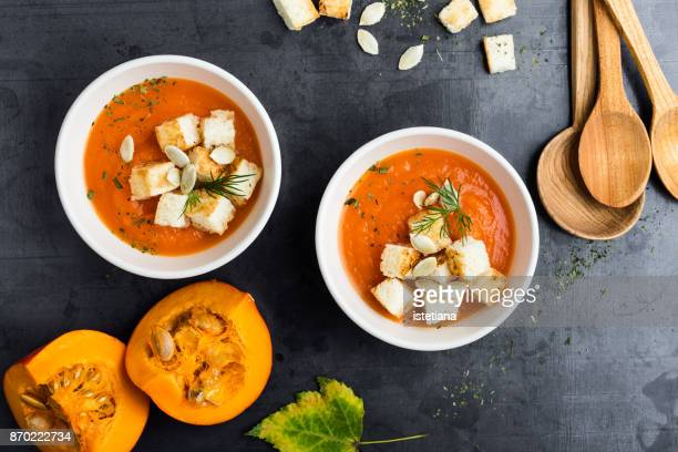 butternut squash cream soup - pureed stock photos and pictures