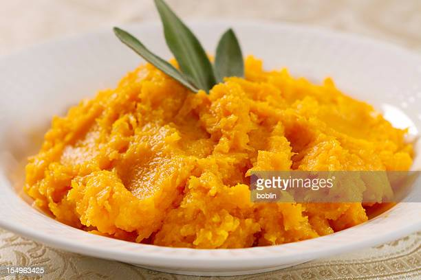 butternut squash prepared in a white bowl - pureed stock pictures, royalty-free photos & images