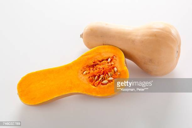 Butternut squash, whole and halved