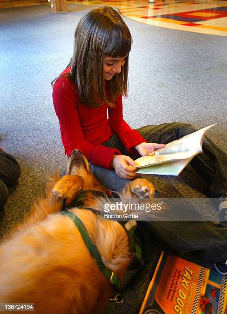 Butternut was ready for a nap while Alyson Stoner from Los Angeles read a book to her as part of the Dog BONES reading program held for the first...
