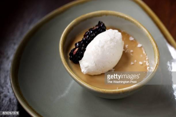 WASHINGTON DC Butterscotch Pot de Crème with Whipped Crème Fraîche and Fleur de Sel at Tredici Enoteca inside the St Gregory Hotel photographed in...