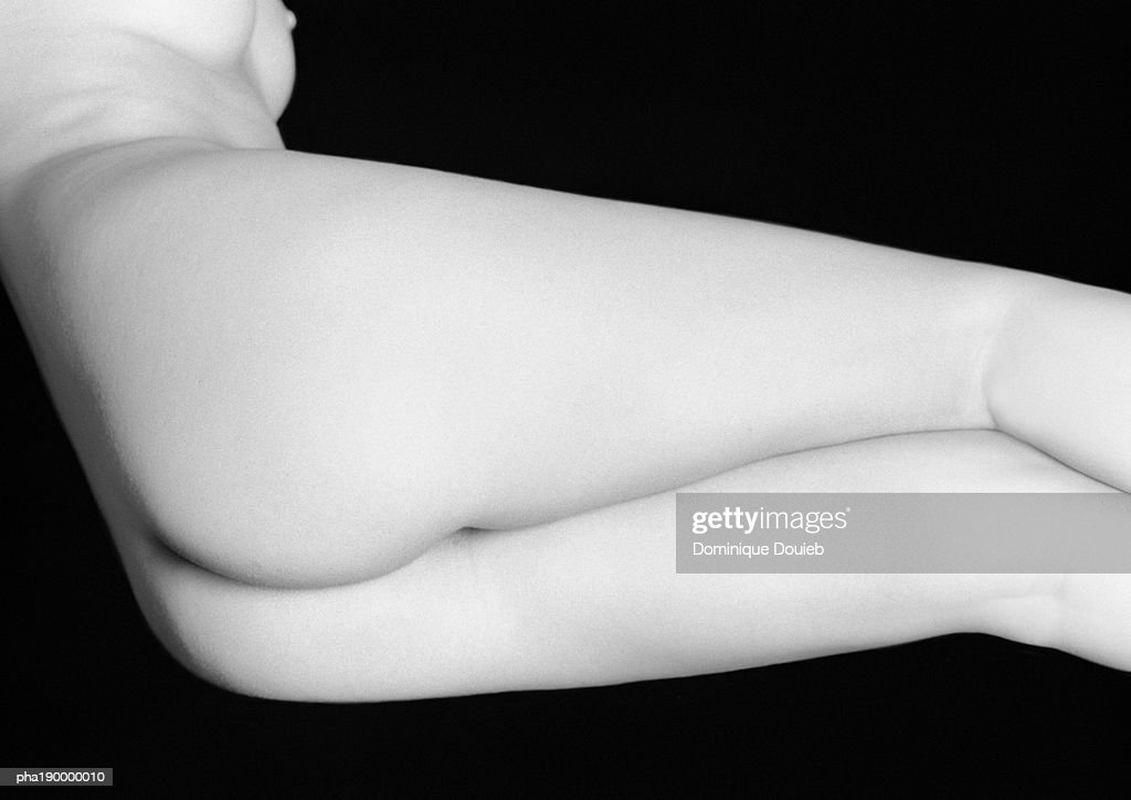 Buttocks and legs of nude woman, close up. : Stockfoto