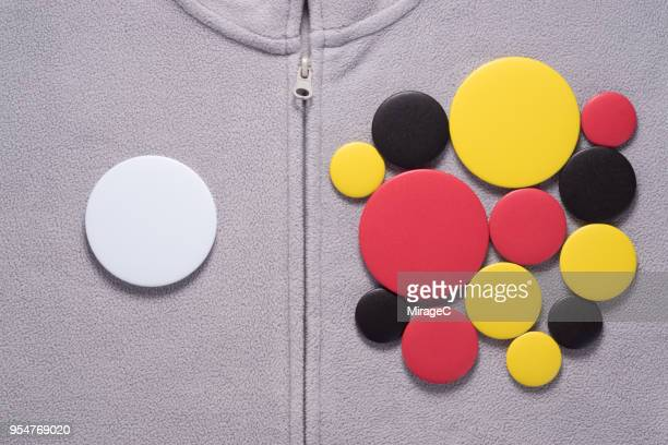 Button Badges on Gray Jacket