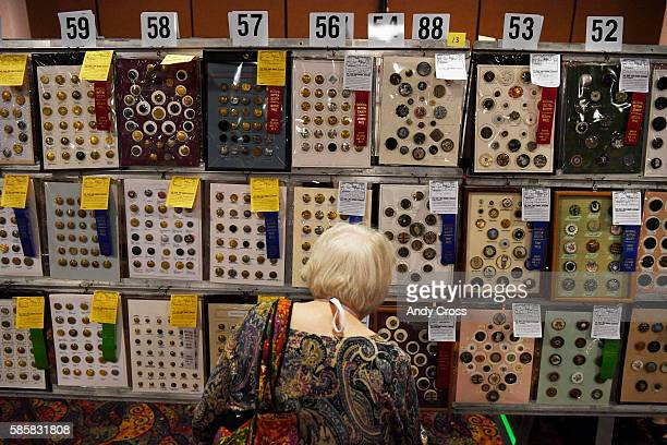 Button collector Phyllis Paule from Minneapolis Minnesota looks over a blueribbon button entry at the Mining in Button Mountains National Button...