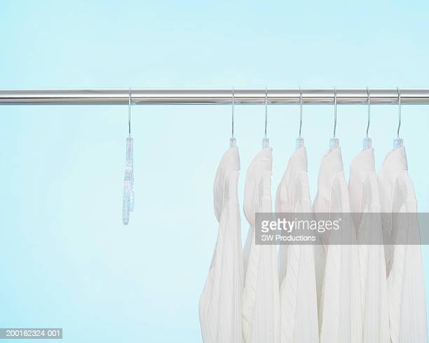 Button down shirts on hangers on clothes rack