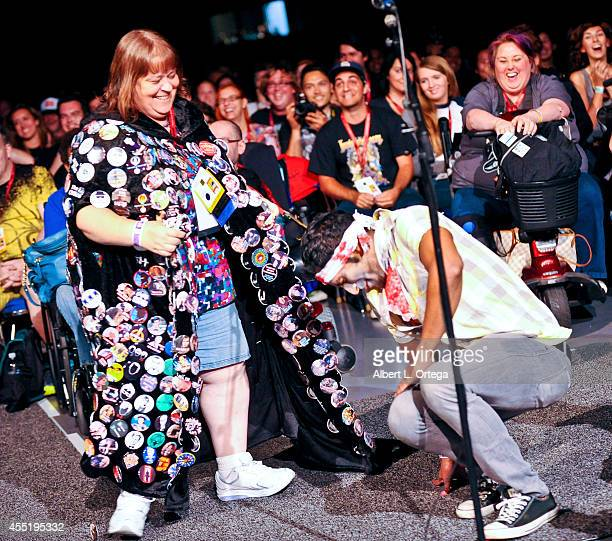 'Button Lady' attacks a zombie after asking a question at AMC's 'The Walking Dead' Panel on Friday Day 2 of ComicCon International 2014 held at San...