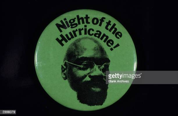 A button promoting 'Night of the Hurricane' a benefit concert by The Rolling Thunder Revue to force a retrial for boxer Rubin 'Hurricane' Carter that...