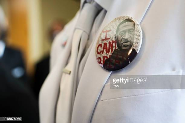I button that reads I can't breathe adorns the jacket of a mourner before the private funeral for George Floyd at The Fountain of Praise church on...