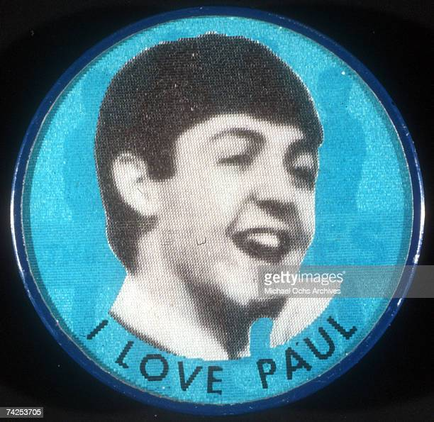 A button which is memorabilia of rock and roll band 'The Beatles' featuring a picture of Paul McCartney reading 'I Love Paul' below