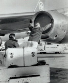 Buttoning up jet intake-a routine procedure-will have to be done to Air Canada planes grounded in To...