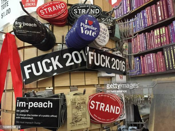 Buttons and stickers with the writing 'Fuck 2016' can be seen at the bookshop 'Strand' in Manhattan US 9 December 2016 Photo Christina Horsten/dpa |...