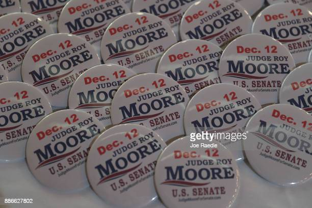 Buttons are seen during a campaign rally for Republican Senatorial candidate Roy Moore at Oak Hollow Farm on December 5 2017 in Fairhope Alabama Mr...