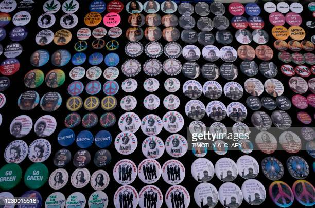 Buttons are seen on the 40th anniversary of John Lennon's death, at Strawberry Fields, in Central Park to honor the late Beatles star in New York on...