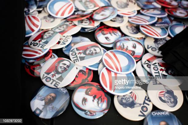 Buttons depicting former President Barack Obama are spread out on a table before Obama spoke at a campaign rally for Ohio Gubernatorial candidate...