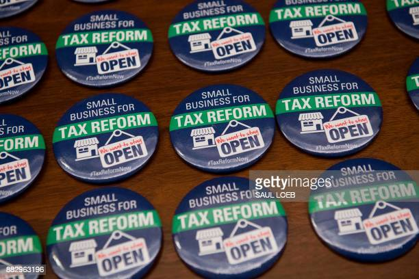 Buttons for supporters of tax reform are seen on Capitol Hill in Washington DC November 30 2017 / AFP PHOTO / SAUL LOEB