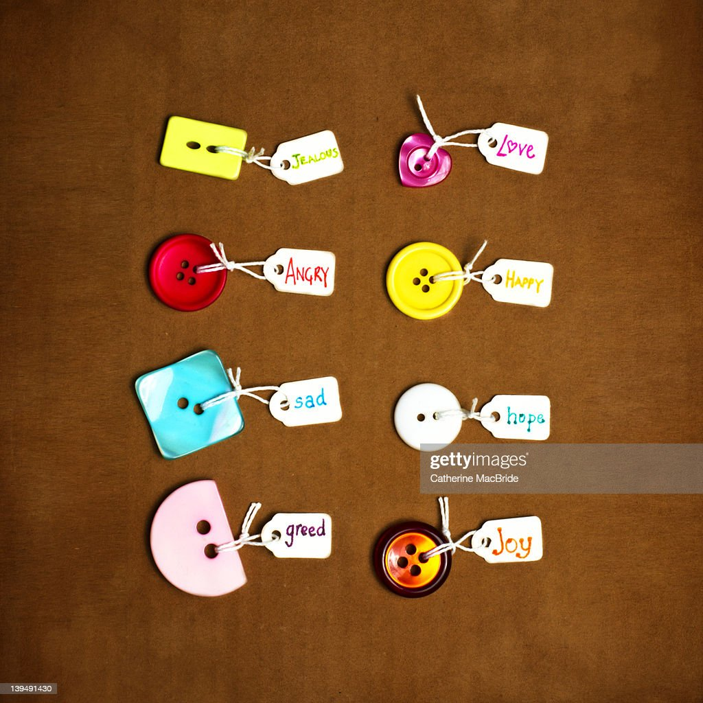 Buttons labeled with various emotions : Foto stock