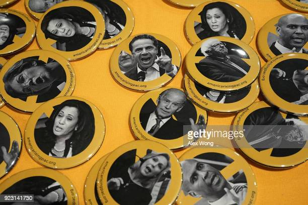 Buttons of possible 2020 presidential contenders including US Sen Bernie Sanders Sen Elizabeth Warren Sen Cory Booker Sen Kirsten Gillibrand Sen...