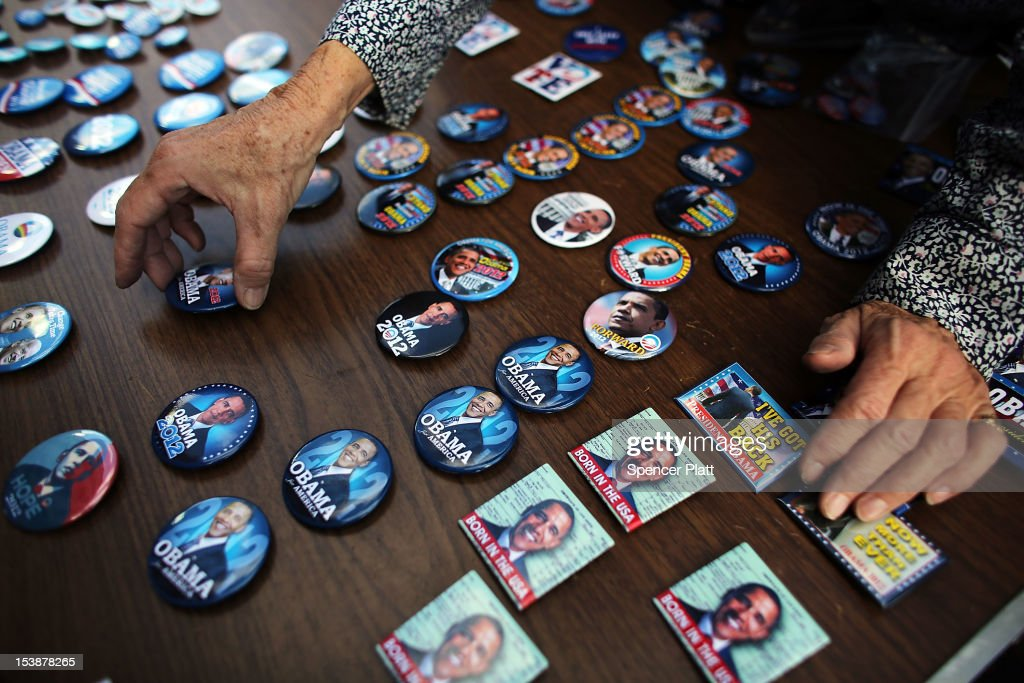 Buttons of President Barack Obama are displayed at a table set up by the Three Peaks Independent Democrats in the Upper West Side of Manhattan on October 10, 2012 in New York City. The group of volunteer democrats works to register voters, sell pins of President Obama and assist in recruiting others to volunteer for the re-election of Obama. Following the Presidents performance in last weeks debate, the race between Obama and GOP candidate Mitt Romney has tightened considerably.