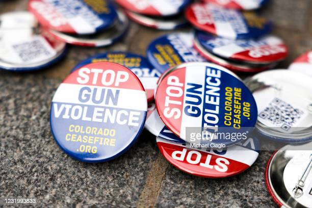 Buttons reading, Stop gun violence, sit on the ground at a gun reform rally at the Colorado State Capitol on March 28, 2021 in Denver, Colorado. Ten...