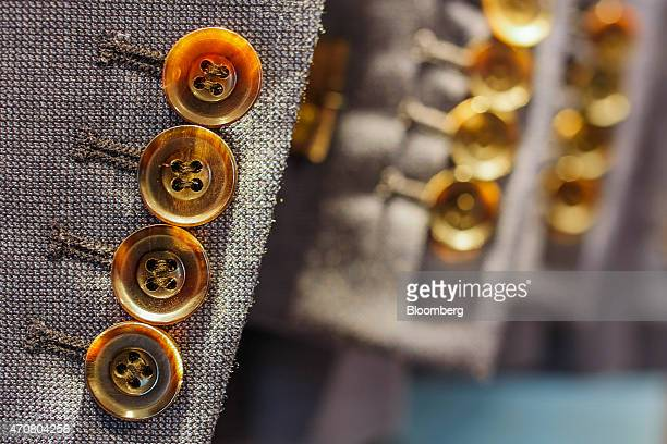 Buttons sit on the cuff of a man's suit in a Marks Spencer Reliance India Pvt store in the Bandra area of Mumbai India on Wednesday April 22 2015...