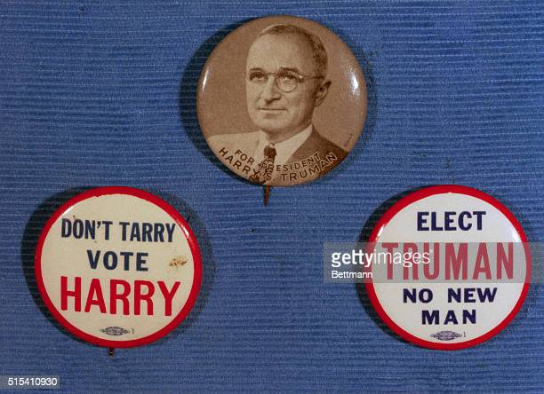 Buttons used in the Harry Truman campaign of 1948 Slogans read 'DON'T TARRY VOTE HARRY' AND 'ELECT TRUMAN NO NEW MAN' Undated photograph