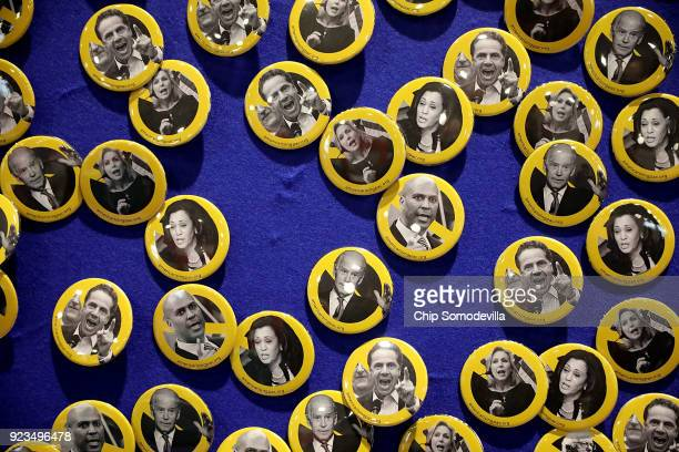 Buttons with the images of prominent Demoratic politicians are on display at the America Rising PAC booth inside the Conservative Political Action...
