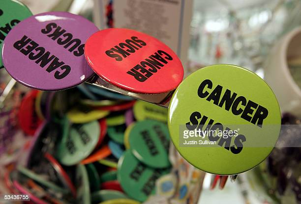 Buttons with the words 'cancer sucks' are seen on display in the gift shop at the UCSF Comprehensive Cancer Center August 18 2005 in San Francisco...