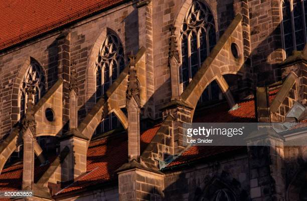 buttresses of st. andreas kirche - kirche stock pictures, royalty-free photos & images