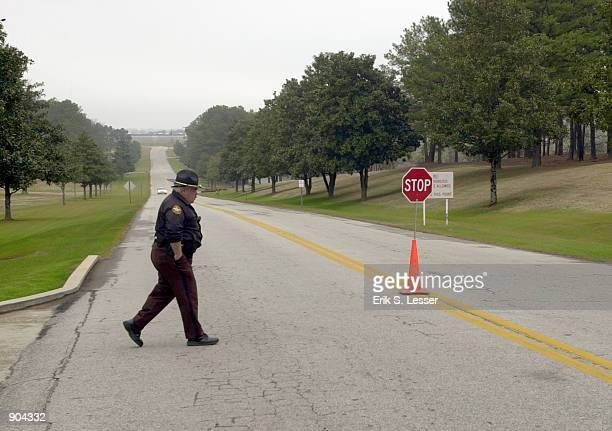 Butts County Sheriff's Deputy patrols the front entrance to the Georgia Diagnostic Prison March 12 2002 in Jackson GA British national Tracy Housel...