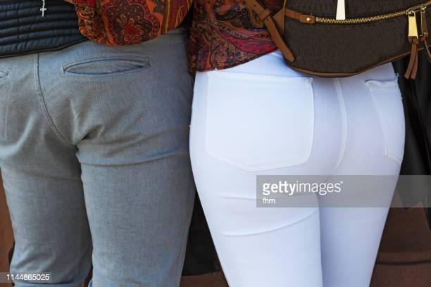 butts of a man and a woman - fesses femme gros plan photos et images de collection