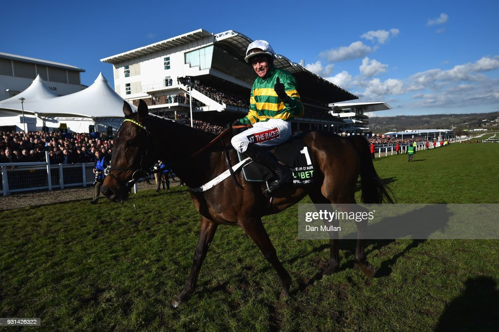 Buveur D'Air ridden by B J Geraghty celebrates victory following the Unibet Champion Hurdle Challenge Trophy on Champion Day of the Cheltenham Festival at Cheltenham Racecourse on March 13, 2018 in Cheltenham, England.
