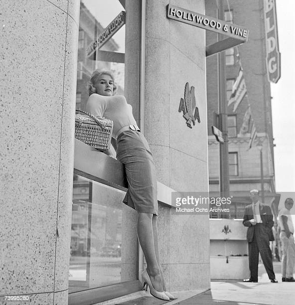 A buxom model poses at the intersection of Hollywood Boulevard and Vine Street in 1958 in Los Angeles California