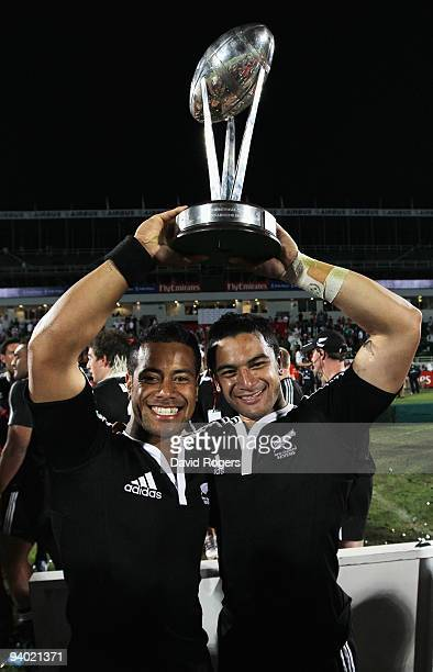 Buxton Popoalii and Sherwin Stowers of New Zealand celebrate after their win over Samoa in the final of the IRB Sevens tournament at the Dubai Sevens...