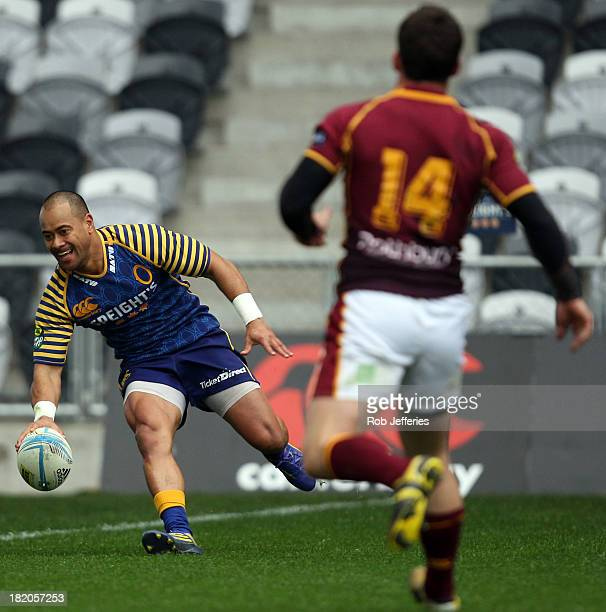 Buxton Popoali'i of Otago scores a try during the round seven ITM Cup match between Otago and Southland at Forsyth Barr Stadium on September 28 2013...