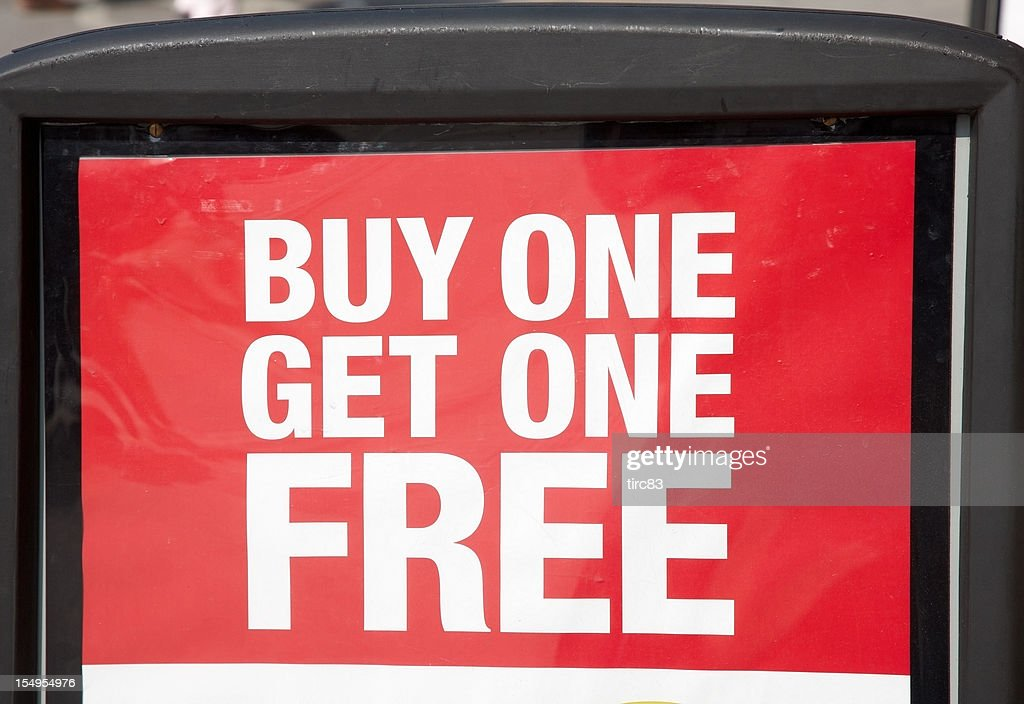 Buy and get one free advertising sign : Stock Photo