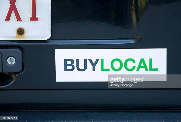 buy local bumper sticker on car - bumper sticker stock photos and pictures