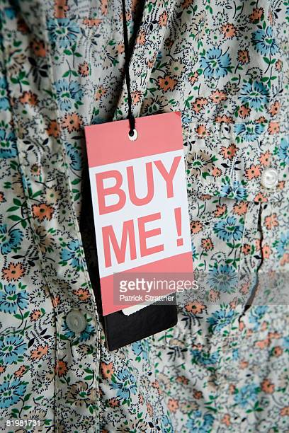 ?Buy Me!? price tag hanging from a lady?s blouse