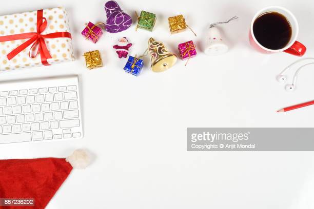 buy send christmas gifts online shopping with computer keyboard clean white background copy area - website template stock photos and pictures
