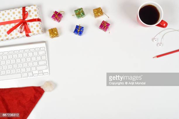 Buy send Holiday gifts online with Christmas gifts, computer keyboard, Christmas decorations, coffee mug clean white copy space