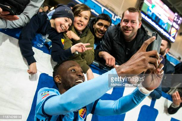 Buya Turay of Djurgardens IF takes selfies with the supporters after winning the Allsvenskan match between Djurgardens IF and IFK Goteborg at Tele2...