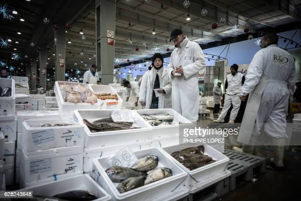 A buyer and a seller are seen at the fish and seafood pavilion of the Rungis international food market in Rungis a southern suburb of Paris on...