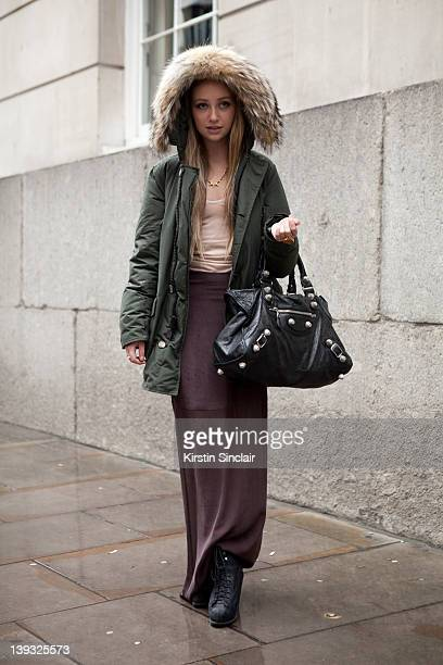 Buyer at teacup boutique Kate Eringer wearing Alexander Wang skirt Faster by Mark Fast slip Rag and Bone boots Dominic Jones necklace Wool rich coat...